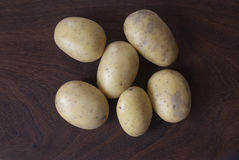 Potatoes. On a wooden background Stock Image