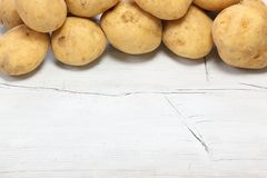 Potatoes in a wooden background Stock Photography