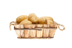 Potatoes in a wooden basket Stock Photo