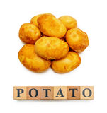 Potatoes and wooden blocks with text Potato  on white Royalty Free Stock Photography