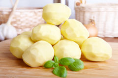 Potatoes on wooden board Royalty Free Stock Photo