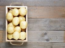 Potatoes in wooden box on table Royalty Free Stock Images