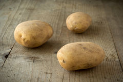 Potatoes on wooden table Royalty Free Stock Image
