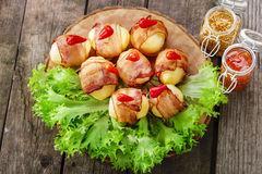 Potatoes wrapped in bacon Royalty Free Stock Image