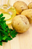 Potatoes yellow with parsley and oil Royalty Free Stock Images