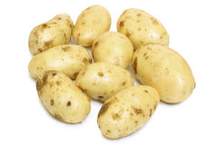 Potatos. Big raw potatos on white background Royalty Free Stock Photography