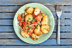 Potatos and chipolatas Stock Images