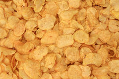 Potatos chips background. Background of fried potatos chips royalty free stock images