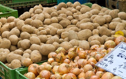 Potatos on market. Potatos and onions in boxes on a market Royalty Free Stock Photo