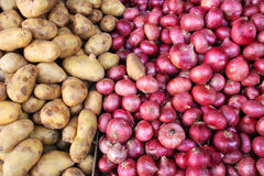 Potatos and onions. Vegetables marketplace in small town - potatos and red onions Stock Photo