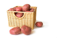 Potatos in Wicker Basket Stock Images