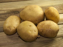Potatos on wood place. Row potatos on wood place Stock Photography
