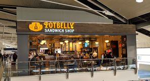 Potbelly Sandwich Shop in Detroit Airport. Detroit, Michigan - March 30, 218: Airport guests enjoying a late lunch at Potbelly Sandwich Shop in Detroit Airport stock image