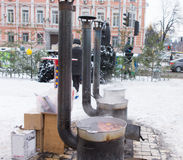 Potbelly stoves in a winter urban environment Stock Images