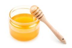 Pote con la miel y el drizzler Fotos de archivo libres de regalías