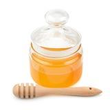 Pote con la miel y el drizzler Imágenes de archivo libres de regalías