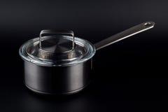 Pote de la cocina en un fondo negro Foto de archivo libre de regalías