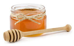 Pote de la miel en fondo blanco aislado Foto de archivo
