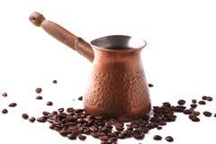 Pote del café en los granos de café Fotografía de archivo