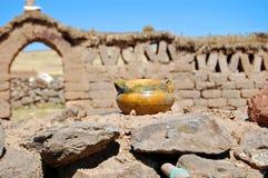 Pote en la pared de piedra Foto de archivo