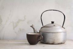 Pote y taza del té Fotografía de archivo