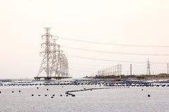 poteau de puissance en mer Photographie stock