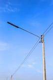 Poteau de réverbère avec un ciel bleu Images stock