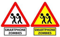 Poteau de signalisation dépeignant deux hommes marchant comme zombis de smartphone Photographie stock