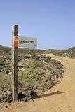 Poteau de signe - RÉUSSITE Photographie stock libre de droits
