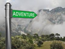 Poteau indicateur d'aventure Photographie stock libre de droits