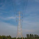 Poteaux à haute tension Photographie stock