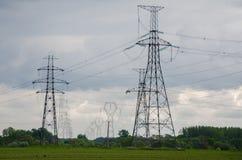 poteaux de Puissance-transmission Photographie stock libre de droits