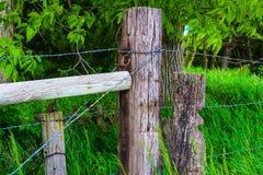 Poteaux en bois de barrière Photographie stock