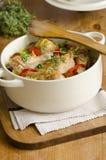 Potenciômetro do arroz da galinha e do chorizo fotos de stock