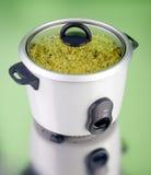 Potenciômetro elétrico do arroz fotografia de stock royalty free