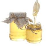 Potenciômetro do mel com colher Foto de Stock