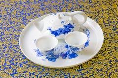Potenciômetro e copo do chá Imagens de Stock