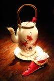 Potenciômetro e palito do chá Fotos de Stock Royalty Free