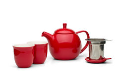Potenciômetro vermelho do chá com os copos de chá ajustados Imagem de Stock Royalty Free