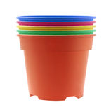 Potenciômetros de flor plásticos coloridos Fotografia de Stock Royalty Free