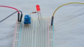 Potentiometer, resistors and red LED set up on a breadboard. Potentiometer, resistors and a red LED set up on a breadboard royalty free stock image