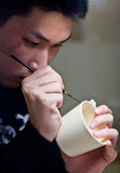 Poterie de peinture d'homme Photo stock