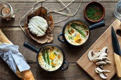 Potes con los huevos cocidos Imagen de archivo libre de regalías