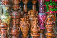 Potes de arcilla con artes Imagen de archivo libre de regalías