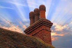 Potes de la pila de chimenea de la cabaña Fotos de archivo