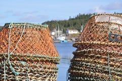 Potes de langosta en el puerto Foto de archivo libre de regalías