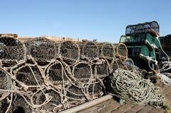 Potes de langosta y redes de pesca Fotos de archivo