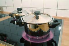 Potes en la estufa Imagen de archivo