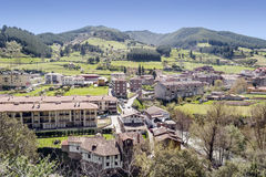 Potes village. Situated in the mountains of Cantabria in the north of spain, you can see  the mountains  with trees in background in a sunny day Royalty Free Stock Images