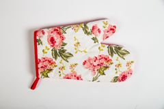 Potholder for hot dishes with white flowers and red border. A potholder for hot dishes with white flowers and red border stock photography